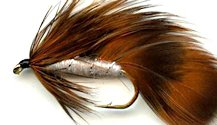 White and Orange Badger Matuka Streamer fly pattern